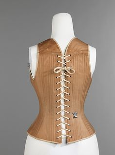 Corset  Madam Griswold's  (American)  Date: 1876 Culture: American Medium: cotton, metal, bone Dimensions: Length at CF (a): 16 in. (40.6 cm)