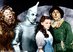 We're off to see the wizard: Bert Lahr as The Cowardly Lion, Jack Haley as The Tin Man, Judy Garland as Dorothy, and Ray Bolger as The Scarecrow, in the beloved movie, The Wizard of Oz