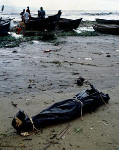 Ugandan fishermen pulling bodies out of Lake Victoria that had traveled hundreds of miles by river from Rwanda (Photo by Dave Blumenkrantz, …  http://globalvoicesonline.org/2009/04/14/rwanda-fifteen-years-after-the-genocide/
