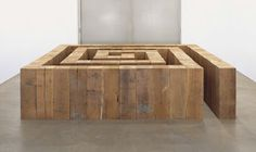 Carl Andre.  ?Lower this design, and widen the gap for a maze of planters?