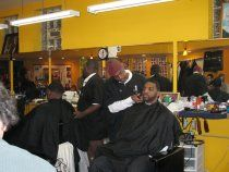 """Shop Talk is a monthly discussion series held by The Public Square and the Institute for Research on Race and Public Policy at the University of Illinois at Chicago. Building on our efforts to bridge the university and the community, """"Shop Talk"""" will bring UIC scholars to Ron's Barber Shop (6058 W. North Ave), in the heart of Chicago's Austin neighborhood"""