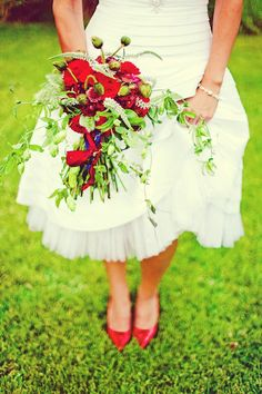 Red whimsical bridal bouquet.  Red wedding flowers.