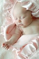 Beautiful baby in  #beautiful organic blanket manufactured by Robbie Adrian in the U.S. 100% cotton organic flannel trimmed in a 1/2 inch pure silk natural pink ribbon. At www.namelynewborns.com we add two free names.