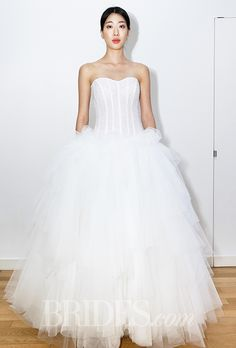 Brides.com: . Trend: Corset Bodices. Strapless ball gown wedding dress with a corset bodice and layered skirt, Elisabetta Polignano