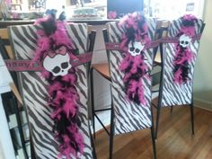Monster High party decor. Cut edges off paper tablecloths. Wrapped with divided feather boa, party streamer and scanned skull icon... and lots of tape!
