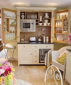 "Another pinner wrote: ""Wouldn't this make a great kitchenette in a studio apartment or granny flat?    I'm assuming the doors fold over each other when not in use."""