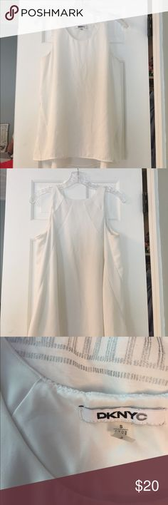 DKNYC Tank Top White razor back Tank with perforated sides. Great condition, super cute!  Size small DKNYC Tops Tank Tops