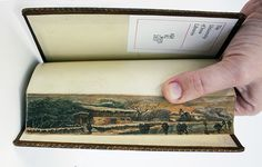 Previously unknown secret paintings discovered on the edge of antique book pages  A few months back, a rare art collection was discovered at the University of Iowa…in the library, of all places.  Colleen Theisen, a staff member with the University's Special Collection and University Archives, found a set of fore edge paintings, meaning paintings done on the outside pages of a book, only discernible when the book's pages are fanned out.  The books wer