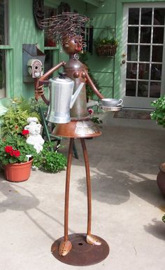 """'Flo, the Waitress' - by Freeman Loughridge;  Flo's coffee is for the birds. The cup is a bird feeder.  She is 5' 6"""" tall."""