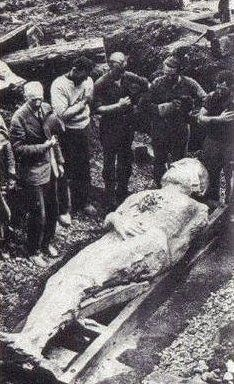 """The fossilized Irish giant from 1895 is over 12 feet tall. The giant was discovered during a mining operation in Antrim, Ireland. This picture is courtesy """"the British Strand magazine of December 1895″ Height, 12 foot 2 inches; girth of chest, 6 foot 6 inches; length of arms 4 foot 6 inches. There are six toes on the right foot. The six fingers and toes remind some people of  Bible passage 2 Samuel 21:20"""