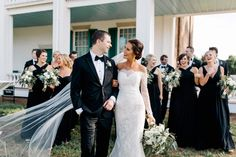 Southern Carnton Plantation Wedding in October  Long sleeve lace wedding dress with seeded eucalyptus bouquets and black bridesmaid dresses by bill levkoff from bella bridesmaids