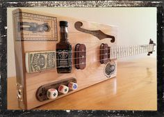 cigarbox guitar | Cigar Box Guitar with Jack Daniels Mini-Bottle Bridge