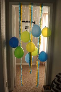 Ruffled streamers and balloons in the doorway to greet the birthday kid.  So easy.  So much fun!