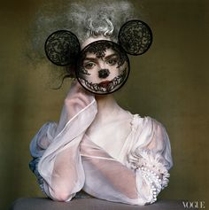 """Irving Penn collaborated with Phyllis Posnick to photograph Lisa Cant in a lace mask in 2005. Julien d'Ys sprayed her hair white, save for one stray wisp. """"There are no accidents,"""" says Posnick. """"There's that curl—her own dark hair unsprayed.""""  Photographed by Irving Penn, Vogue, 2005 / Courtesy of Abrams"""