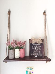 Rustic handmade wood Hanging Shelf with Rope. Beautiful piece to display hand painted Mason Jars, flowers, etc. Wood: hand painted and distressed. Measures 24 long and width Beautiful hand painted Mason Jars are also available for sale at our shop. Distressed Mason Jars, Painted Mason Jars, Diy Wall Art, Diy Wall Decor, Wall Decorations, Room Decor, Rustic Decor, Farmhouse Decor, Rustic Style