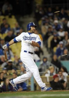 Andre Eithier breaks his bat as he drives in two runs during a 9-8 victory over the Padres April 13, 2012.