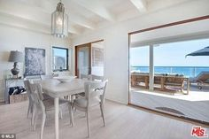 The oceanfront deck steals the show. It has transparent siding so as not to…
