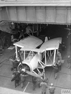 """stukablr:""""Fairey Swordfish aircraft being pushed into the hangar on board HMS TRACKER. Navy Aircraft, Ww2 Aircraft, Aircraft Carrier, Military Aircraft, Fairey Swordfish, Royal Air Force, Historical Pictures, Royal Navy, Military Vehicles"""
