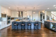 Custom two-tone gourmet kitchen in Modified Logan floor plan by DJK Homes.