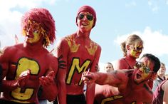 Central Michigan University students go all out with maroon and gold body paint to show their school spirit at football games in the Kelly/Shorts Stadium.