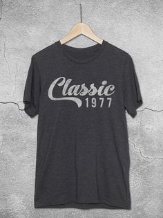 The perfect 40th birthday gift idea for men and women! This unisex shirt features the 'Classic 1977' burnout graphic design printed on a soft, graphite t-shirt.