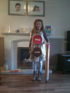 World book day dress up Thumbelina - I made a giant pencil by rolling card and decorating appropriately and I also made oversize buttons from coloured foam using ribbon as the thread. Girls fancy dress book character.