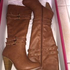 Brown-heeled boots Never worn Brand New . Bought em online, but they came out to be kind of big. Never used. JustFab Shoes Heeled Boots