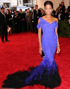 Dramatic: Skyfall star Naomie Harris was beautiful in a blue gown featuring a graduated blue feathered train ~ Met Gala, May 2013