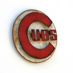 """Chicago CUBS wall art logo 12"""" diameter - white and red with rust patina - indoor outdoor"""