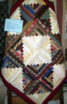 I am a beginner quilter, and a member of the Thursday night Buderim Quiltinggroup. This reversible log cabin quilt was made from the inspiration and guidancefrom Marlene Hogan of the same group. It is all machine pieced and stitched by