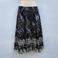 "Tapemeasure Anthro Sz 6 Lined Floral Skirt NWOT Tapemeasure Anthropologie Sz 6 Lined Floral Skirt NWOT Polyester Blue Brown Tan colors Length 25""Waist 15 1/2 across laying flatscrunched gathered front and backNWOT Anthropologie Skirts"