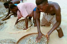 Workers pan for diamonds in a government controlled diamond mine June 15, 2001 near Kenema, Sierra L... - Chris Hondros/Getty Images