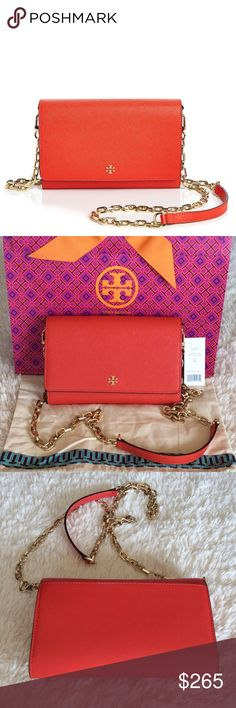 """BRAND NEW TORY BURCH WALLET ON CHAIN/POPPY RED Authentic. Brand new with tags. This bag has dust bag and gift bag. Crossbody chain strap. Magnetic snap closure; lined. Two interior slip pockest, 16 credit card slots, interior zip pocket, exterior slip pocket. Logo plaque at front, gold-tone hardware. 7.5""""L x 2""""W x 5""""H; 23"""" strap drop. Saffiano leather. PLEASE🚫NO TRADE🚫THE PRICE IS FIRM🚫 Tory Burch Bags Crossbody Bags"""