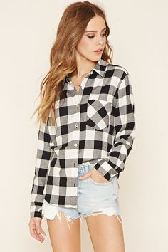 A long-sleeved shirt crafted from a woven plaid flannel with a buttoned front, a basic collar, a chest patch pocket, a curved hem, and buttoned cuffs.