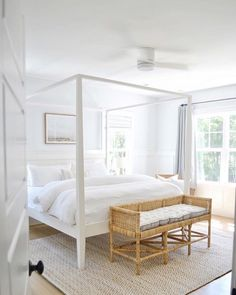 modern coastal bedroom decor with modern four poster bed and white bedding, neutral bedroom with jute rug and white walls, all white bedroom decor, cottage bedroom decor Coastal Master Bedroom, White Bedroom Decor, Coastal Bedrooms, Master Bedroom Design, Home Bedroom, Modern Bedroom, Bedroom Ideas, Contemporary Bedroom, White Bedrooms