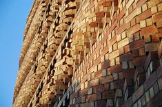 for the design of the SAHRDC office building in new dehli, india, anagram architects has designed an office building featuring a porous angled-brick wall. Brick Wall, Architects, Paintings, Building, Wood, Paint, Woodwind Instrument, Painting Art, Buildings