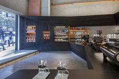 jones   haydu have designed the Coffee Bar, a cafe in San Francisco that features scorched wood siding