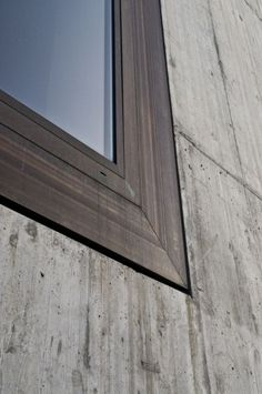 Window detail of Valerio Olgiati's School in Paspels. Concrete and bronze - like the use of bronze detail