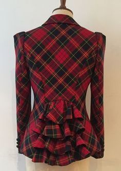 Stunning fitted and tailored bias cut 4 button jacket with a super-chic 4-frill detail at the back. This jacket is made in tartan poly/viscose fabr...