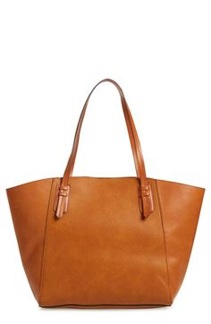 Free shipping and returns on Sole Society Faux Leather Trapeze Tote at Nordstrom.com. A roomy faux-leather tote in a lightly structured trapeze silhouette is topped with easy over-the-shoulder handles and features a flat base for stability.