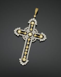 This magnificent cross pendant is bejeweled with a blend of yellow and white diamonds totaling 3.26 carats. ~ M.S. Rau Antiques
