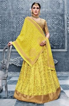 Get the simplicity and prettiness with this lemon yellow banarasi silk lehenga choli. This lehenga is displaying some really innovative designs of thread work and lace work. Comes with matching choli and dupatta. Bollywood Lehenga, Lengha Choli, Lehenga Choli Online, Indian Lehenga, Silk Lehenga, Bollywood Fashion, Anarkali, Sarees, Silk Dupatta