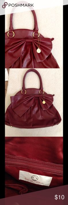 Big Buddha Red Large Tote With Bow Detail Cute and perfect for school! This is a large bag that can hold a lot. In good condition. Has loops for a crossbody strap, but I do not have the strap. Questions and offers are welcome  Big Buddha Bags Totes