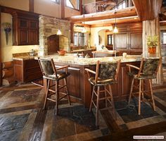 Very unique flooring with a mix of hardwood and Stone. The larger Stone pieces are visually appealing yet the wood offers a good break. Home, Kitchen Flooring, Building A New Home, Timber Frame Homes, Flooring, Cabin Kitchens, Timber House, Log Homes, Home Deco