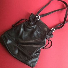 Buttery soft black leather handbag Buttery soft leather handbag (super soft like an expensive pair of leather gloves) lightweight too. Leather drawstring closure. Awesome bag  New, no signs of wear Bags