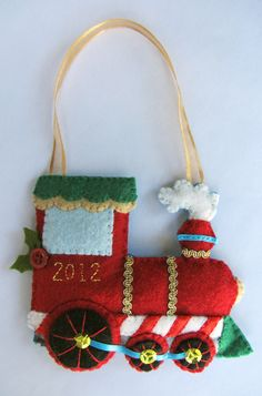 felt train ornament tutorial - adapted to be the Hogwarts express? Felt Christmas Decorations, Christmas Ornaments To Make, Christmas Sewing, Noel Christmas, Christmas Projects, Felt Crafts, Handmade Christmas, Holiday Crafts, Christmas Train