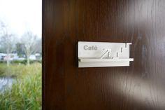 Elegant wayfinding signs Ada Signs, Window Reveal, Architectural Signage, Wayfinding Signs, Door Handles, Typography, Elegant, Door Knobs, Letterpress