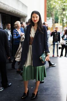 Start with an easy cotton dress. Throw on a structured wool coat and roll the sleeves. Grab a chunky bracelet, cool heels, a clutch. Add red lipstick.