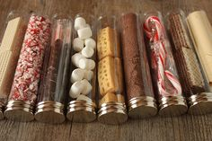 HOT COCOA KIT:  Fill plastic tube containers with anything good to mix or dunk in a cup of cocoa. Marshmallows,   Fine shavings, cocoa powder  - Crushed candy canes.  - Malted milk powder   - Miniature shortbread cookies  - Chocolate dipped candy cane sticks or miniature candy canes