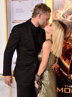 Pin for Later: Jessica Simpson and Eric Johnson's PDA Is Out-of-Control Sexy  Eric and Jessica shared a sweet smooch on the red carpet at the LA premiere of The Hunger Games: Mockingjay - Part 1 in November 2014.
